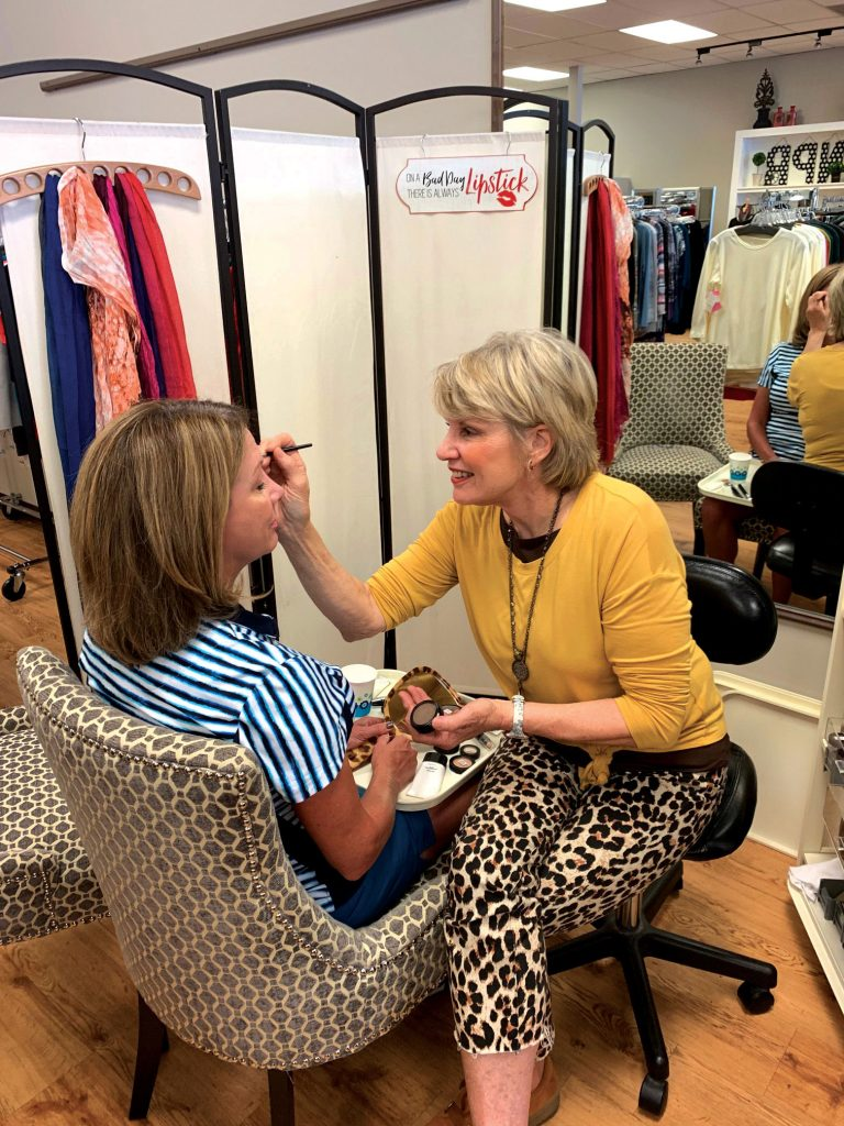 Never Pay Retail's owner Ann Fulton doing a color consultation.