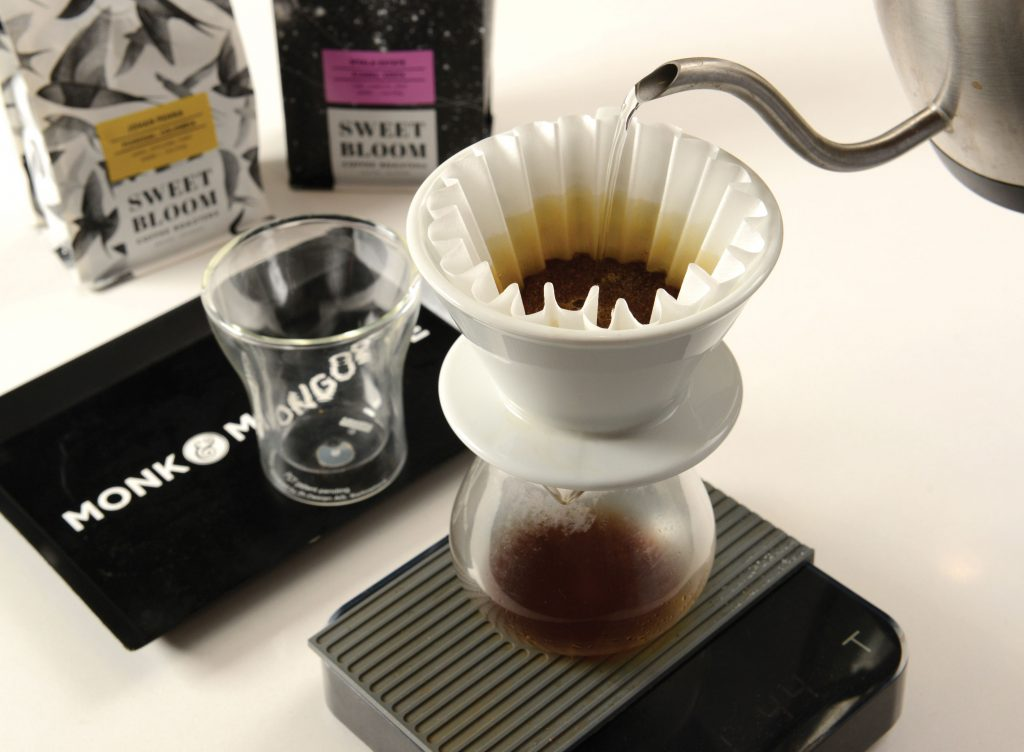 Josiah Rothlisberger of Monk and Mongoose Gourmet Coffee is making a cup of joe.
