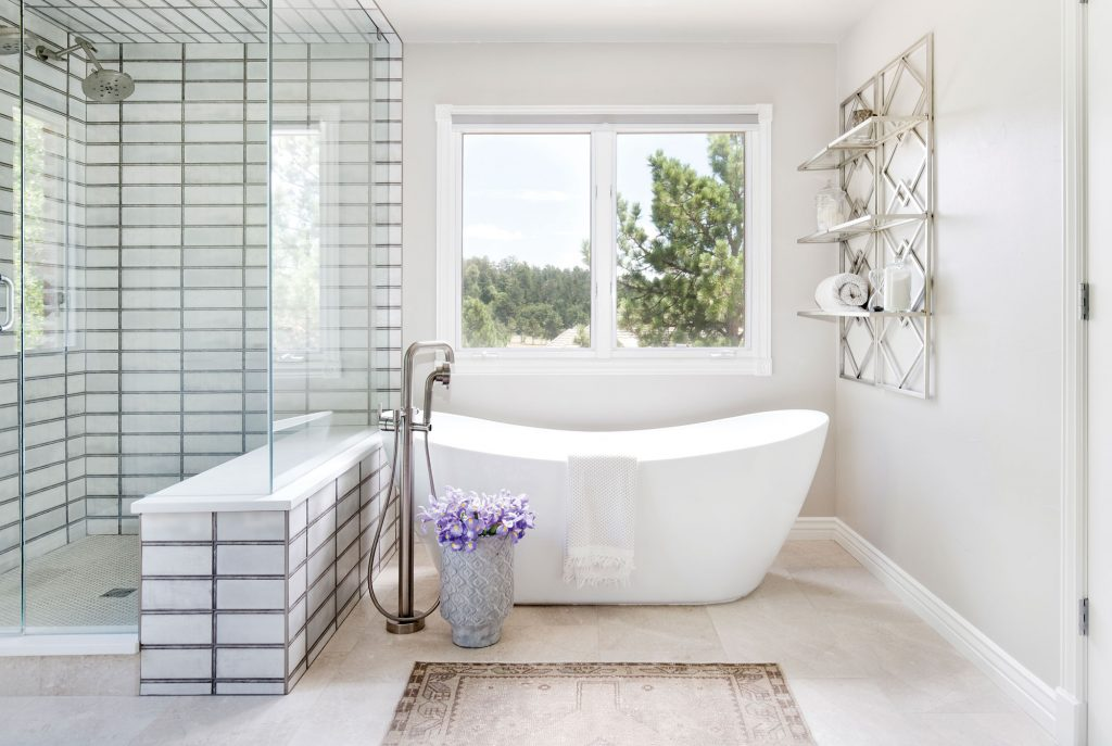 The large window-pane-like shower tile in the master bathroom is an unexpected focal point.
